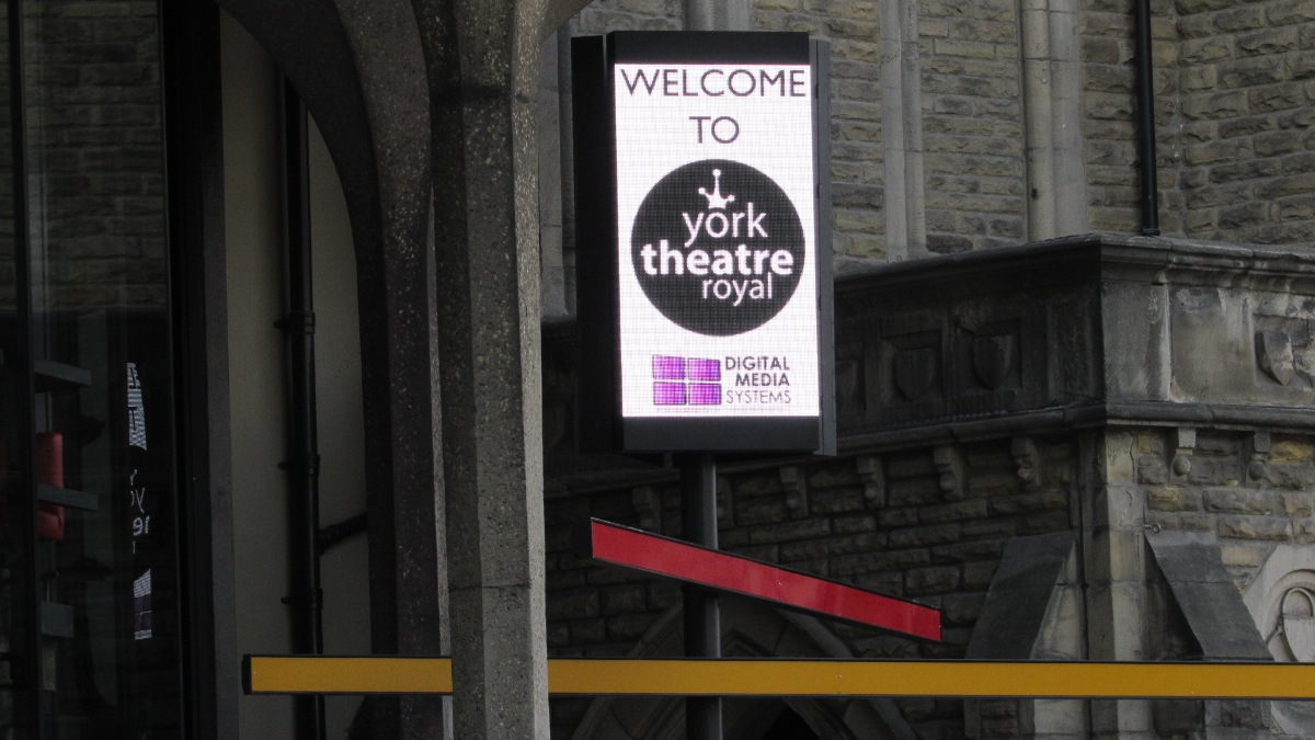 Outdoor LED display times 3 at York Theatre Royal. In triangle formation on entrance canopy